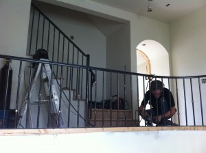 Joseph working on the railing installation.
